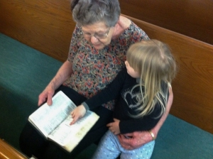 Mom reading Scripture to Lucy