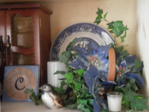 I love the little bird figurine given to me on my 16th Birthday by my Mother, along with a large Picnic Basket, which she explained would have to serve as my