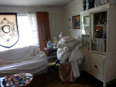 Before Photo of our Messy, Cluttered  Living Room